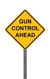 Attention - contrôle des armes en avant Photographie stock
