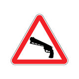 Attention crime. Gun in red triangle. Road sign Caution Weapon Stock Photos