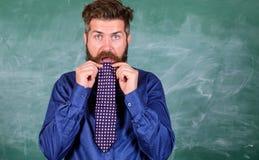 Attention de salaire à votre comportement et façons L'étiquette de professeur incline le professionnel moderne d'éducation Le pro image libre de droits