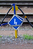 Attention electricity. An blue electricity board with a cabel Stock Photo