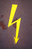 Attention electricity. A drawn electricity board on a rusty metal Royalty Free Stock Photo