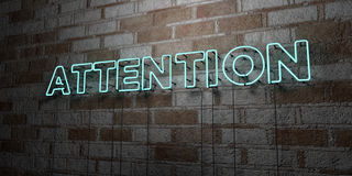 ATTENTION - Glowing Neon Sign on stonework wall - 3D rendered royalty free stock illustration Royalty Free Stock Photography