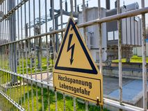 Attention! High voltage! risk of death! in german royalty free stock photography