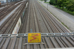 Attention high voltage sign train tracks in german language. Attention high voltage sign near train tracks in german language Stock Photography