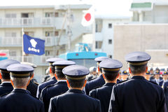 Attention Japanese police officers  Stock Images