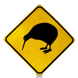Attention Kiwi Crossing Road Sign. New Zealand Road Sign: Attention Kiwi Crossing isolated on white background royalty free stock photo