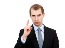 Attention man. Serious businessman is trying to pay attention on something Stock Photography