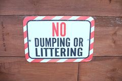 Attention! No dumping or littering. A Notice. No dumping or littering. To keep clean royalty free stock images