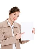Attention please. Portrait of smart businesswoman attracting our attention at blank paper sheet stock photography