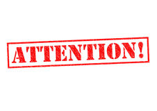 ATTENTION!. Red Rubber Stamp over a white background stock photo