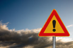 Attention road sign on a background with a dramatic sky Royalty Free Stock Photography