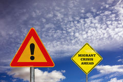 The attention road sign with migrant crisis ahead Royalty Free Stock Image
