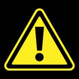 Attention sign on black background. Hazard warning attention sign. Icon in a yellow triangle with exclamation mark symbol, isolated on a black background Stock Image