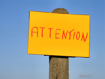 Attention sign post Stock Photos