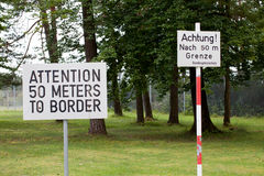 Attention sign posted at Checkpoint Alpha in East Germany. Warning signs of attention posted in English and German at Checkpoint Alpha site in East Germany Royalty Free Stock Photos