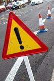 Attention sign. Road traffic limited. Triangle with red border. Bypass at the street Royalty Free Stock Photography
