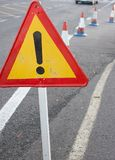 Attention sign. Road traffic limited. Triangle with red border. Bypass at the street. Attention sign. Road traffic limited. Triangle with red border. Bypass stock images
