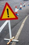 Attention sign. Road traffic limited. Triangle with red border. Bypass at the street Stock Images