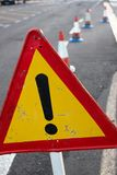 Attention sign. Road traffic limited. Triangle with red border. Bypass at the street. Attention sign. Road traffic limited. Triangle with red border. Bypass Royalty Free Stock Images