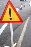Attention sign. Road traffic limited. Triangle with red border. Bypass at the street Royalty Free Stock Photo
