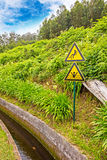 Attention sign at the water supply, Madeira Royalty Free Stock Photo
