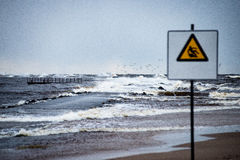 Attention signs near sea with stormy weather Stock Photo