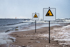 Attention signs near sea with stormy weather Stock Photography