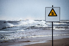 Attention signs near sea with stormy weather Stock Image