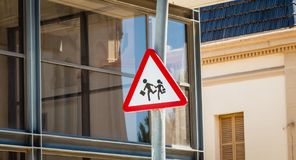 Attention to children panel placed in front of a modern glass bu. Ilding in Spain Royalty Free Stock Photography