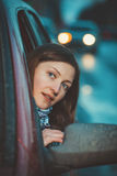 Attention to the road. A young woman looks out of the car royalty free stock photos