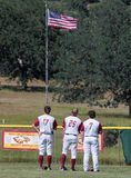 At Attention. West Valley baseball  players stand at attention  before a game in Cottonwood, California Royalty Free Stock Images