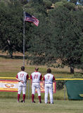 At Attention. West Valley baseball  players stand at attention  before a game in Cottonwood, California Stock Image