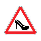 Attention woman. Red prohibitory road sign women`s shoes. Stock Photo