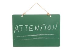 Attention word on green board Royalty Free Stock Photography