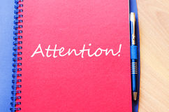 Attention write on notebook Royalty Free Stock Images