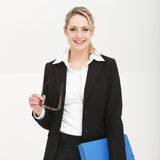 Attentive administrative assistant. Smiling as she stands waiting for instructions Royalty Free Stock Image
