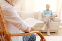 Attentive aged woman reading something Stock Photo