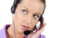 Young adult female call center woman telephone headset close up, looking sideways, white background Royalty Free Stock Image
