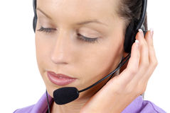 Young adult female call center woman telephone headset close up, looking down, white background Stock Photography