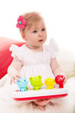 Attentive baby girl looking away Royalty Free Stock Images
