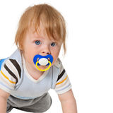 Attentive baby with a pacifier Royalty Free Stock Photos