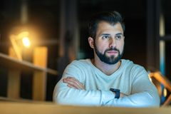 Attentive bearded man being deep in thoughts Royalty Free Stock Photos