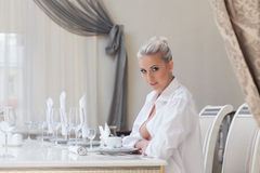 Attentive beautiful girl posing in restaurant Stock Photography