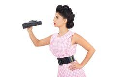 Attentive black hair model using binoculars Stock Photography