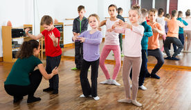 Attentive boys and girls rehearsing ballet dance in studio. Attentive boys and girls primary school age rehearsing ballet dance in studio stock photography