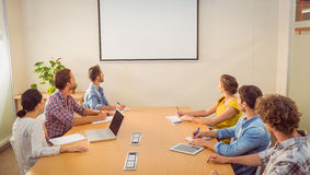 Attentive business team following a presentation Royalty Free Stock Photos