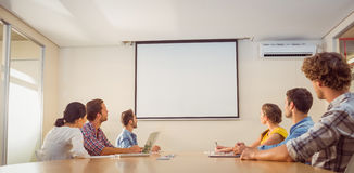 Attentive business team following a presentation Stock Photo