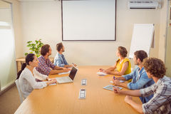 Attentive business team following a presentation. In the office Royalty Free Stock Photos