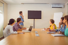 Attentive business team following a presentation Stock Images
