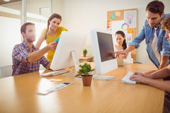 Attentive business team working on laptops Stock Image